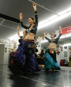 Gorgeous Asian bellydancer dressed in traditional attire