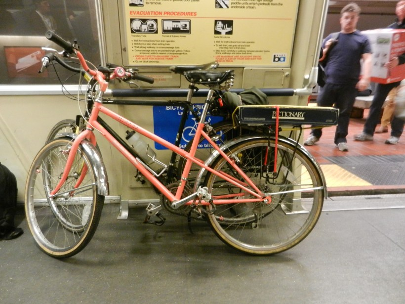 pink step through and touring bike