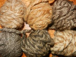 six tiny balls of coffee-dyed handspun wool yarn in various rich shades from chocolate to cinnamon