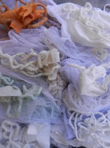 Pile of white and off-white yarns and cottons in slightly varying shades.
