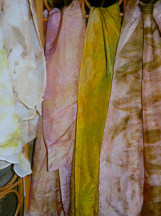 Pink and yellow ecoprint silk scarves, hand-dyed with natural dyes.