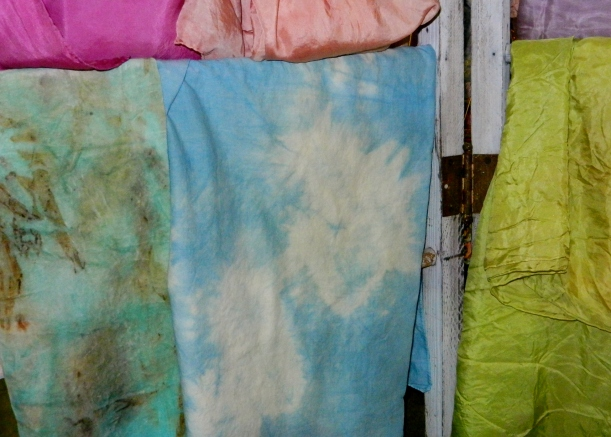 Bright blue, pink, and green silk scarves, hand-dyed with natural dyes.