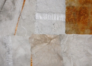 Seven fabric swatches, mostly greyish, but with variety in shade and mottling.
