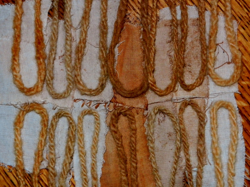 Lichen-dyed wool and cotton. Wools are various shades of honey, maple, bronze. Cottons are blech.