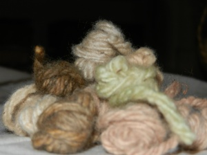 Little balls of dyed yarns in a pile.