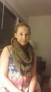 pretty young woman wearing her hand-knitted alpaca cowl