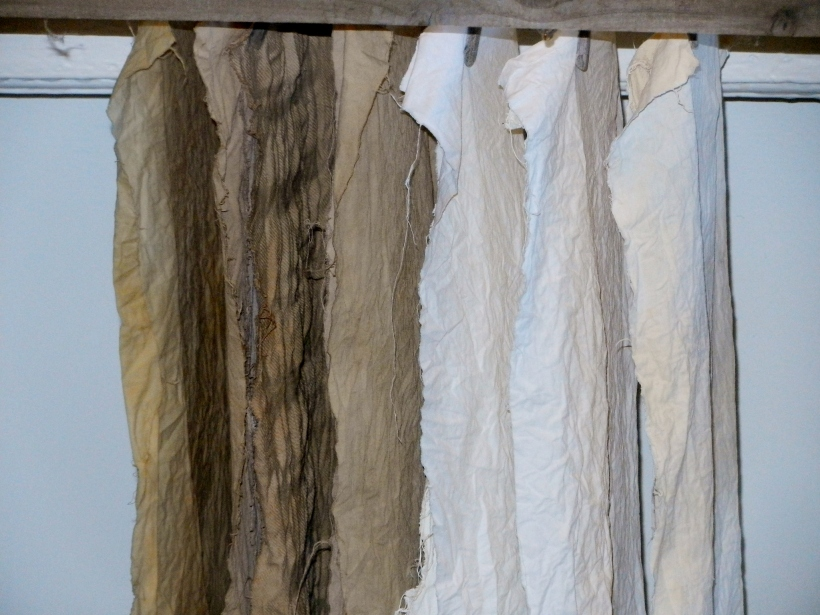 Tanish beigish and white cottons hanging to dry over a heater.