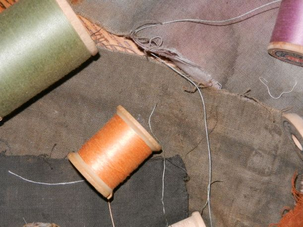 Charcoal, dark olive, grey and bougainvillea naturally dyed fabric samples with orange, and lime thread.