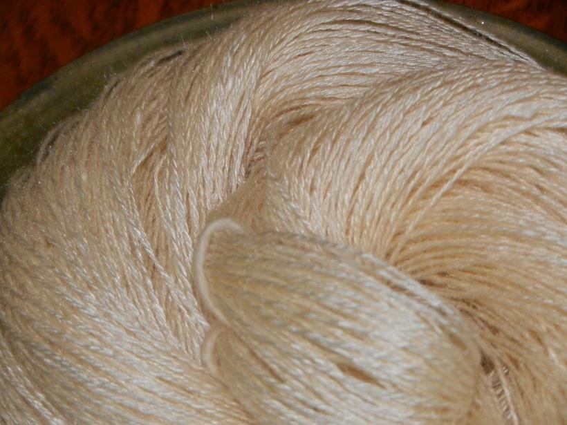 Fine, lustrous, white, drapy three-ply handspun bombyx silk.