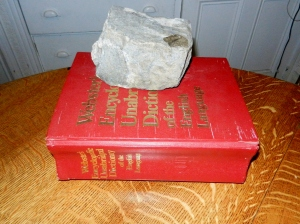 huge dictionary with a rock on top