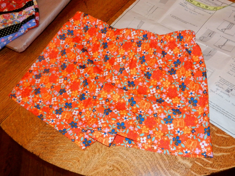 Orange boxer shorts with yellow, blue, and white flowers, and yellow butterflies. Ouch, my eyes.