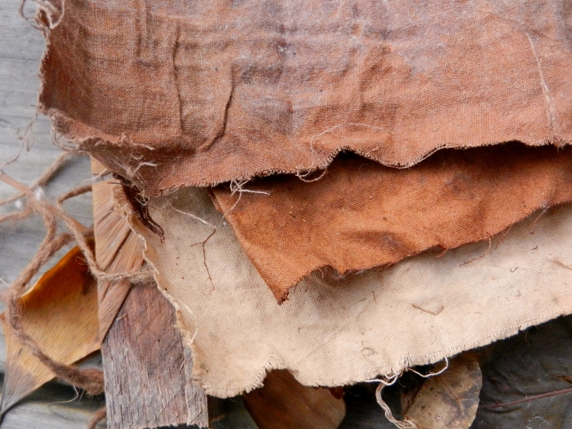 Edges of dock/lichen/eco-printed cotton. Rich browns, but only shadowly leaf prints.