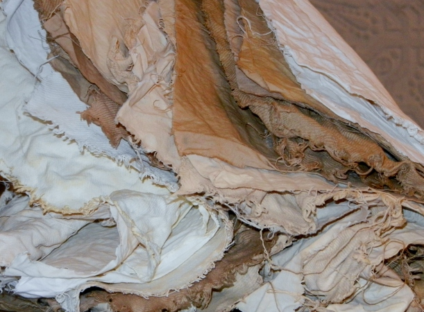 Glorious and highly textured pile of mordanted cottons, from light cream through coffee with cream.